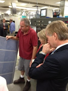 Governor and Mrs. Bob McDonnell inspect the book's pages as they come off the press.